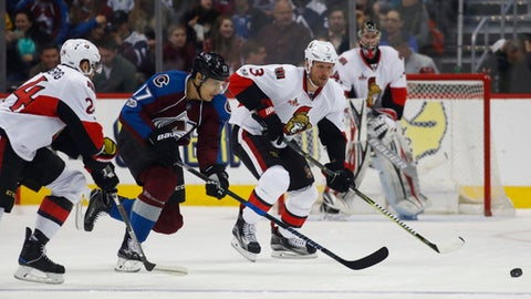 Colorado Avalanche right wing Rene Bourque, center, pursues the puck with Ottawa Senators left wing Viktor Stalberg, left, of Sweden, and defenseman Marc Methot in the second period of an NHL hockey game Saturday, March 11, 2017, in Denver. (AP Photo/David Zalubowski)