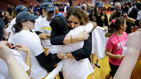 Long Beach State head coach Jody Wynn, center right,, hugs her player as they celebrate after defeating UC Santa Barbara in an NCAA college basketball game for the championship of the Big West tournament Saturday, March 11, 2017, in Anaheim, Calif. (AP Photo/Jae C. Hong)
