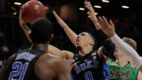 Duke Blue Devils forward Jayson Tatum (0) puts up a shot against Notre Dame Fighting Irish in the first half of an NCAA college basketball game during the championship game of the Atlantic Coast Conference tournament, Saturday, March 11, 2017, in New York. (AP Photo/Julie Jacobson)