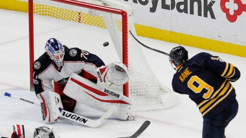 Buffalo Sabres forward Evander Kane (9) puts the puck past Columbus Blue Jackets goalie Joonas Korpisalo (70) during the third period of an NHL hockey game, Saturday, March 11, 2017, in Buffalo, N.Y. (AP Photo/Jeffrey T. Barnes)