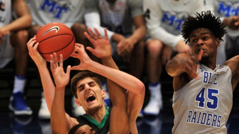 Middle Tennessee's Edward Simpson (11) goes for a rebound in the first half of the NCAA college basketball game against Marshall during the championship game of the Conference USA tournament, Saturday, March 11, 2017, in Birmingham, Ala. (AP Photo/Eric Schultz)