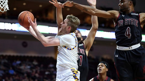 Cal State Bakersfield guard Brent Wrapp (1) slides to the basket past New Mexico State center Tanveer Bhullar (21) and guard Ian Baker (4) during the first half of their NCAA college basketball game in the final of the Western Athletic Conference tournament Saturday, March 11, 2017, in Las Vegas. (AP Photo/L.E. Baskow)