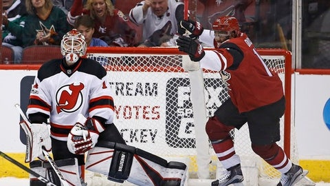 Arizona Coyotes left wing Anthony Duclair, right, celebrates a goal by teammate defenseman Anthony DeAngelo against New Jersey Devils goalie Keith Kinkaid, left, during the third period of an NHL hockey game Saturday, March 11, 2017, in Glendale, Ariz.  The Coyotes defeated the Devils 5-4. (AP Photo/Ross D. Franklin)