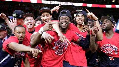 Arizona players celebrate as they pose for photographers after defeating Oregon 83-80 in an NCAA college basketball game for the championship of the Pac-12 men's tournament Saturday, March 11, 2017, in Las Vegas. (AP Photo/John Locher)