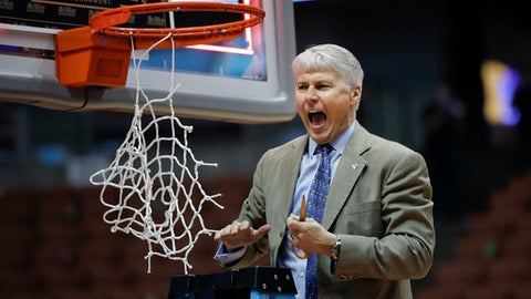 UC Davis head coach Jim Les fires up his players as he prepares to cut the net after his team's 50-47 win against UC Irvine in an NCAA college basketball game for the championship of the Big West tournament  Saturday, March 11, 2017, in Anaheim, Calif. (AP Photo/Jae C. Hong)