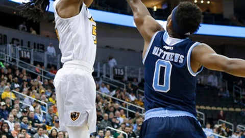VCU's Doug Brooks (5) shoots fopr three over Rhode Island's E.C. Matthews (0) during the first half of an NCAA college basketball game in the Atlantic 10 tournament championship, Sunday, March 12, 2017, in Pittsburgh. (AP Photo/Keith Srakocic)
