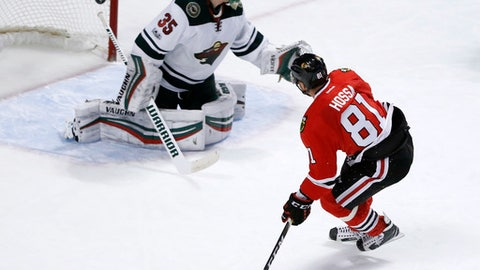 Chicago Blackhawks' Marian Hossa (81) watches his shot score past Minnesota Wild goalie Darcy Kuemper during the third period of an NHL hockey game, Sunday, March 12, 2017, in Chicago.The Blackhawks won 4-2. (AP Photo/Charles Rex Arbogast)