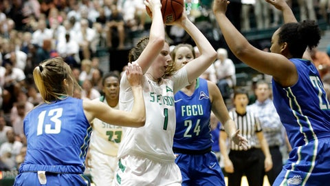 Stetson's Sarah Sagerer (1) makes a moves to the basket against Florida Gulf Coast's Jordin Alexander (13), Taylor Gradinjan (24) and China Dow, right, during the first half of an NCAA Atlantic Sun Conference college championship basketball game, Sunday, March 12, 2017, in DeLand, Fla. (AP Photo/John Raoux)