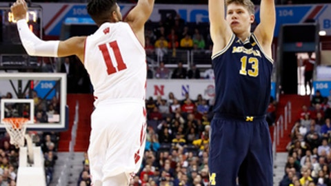 Michigan forward Moritz Wagner (13) shoots over Wisconsin guard Jordan Hill (11) during the first half of an NCAA college basketball game for the Big Ten tournament title, Sunday, March 12, 2017, in Washington. (AP Photo/Alex Brandon)