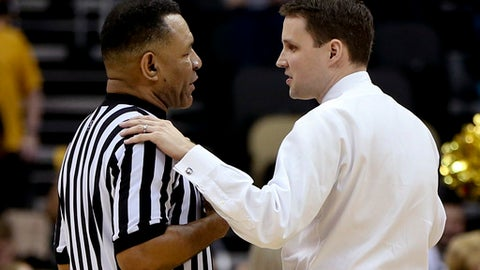 VCU head coach Will Wade, right, talks with an official in a timeout during the second half of an NCAA college basketball game against Rhode Island in the Atlantic 10 tournament championship, Sunday, March 12, 2017, in Pittsburgh. (AP Photo/Keith Srakocic)