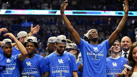 Kentucky players celebrate after beating Arkansas in an NCAA college basketball game for the championship of the Southeastern Conference tournament Sunday, March 12, 2017, in Nashville, Tenn. Kentucky won 82-65. (AP Photo/Sanford Myers)