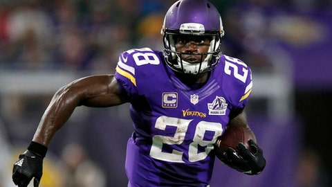 FILE - In this Sept. 18, 2016, file photo, Minnesota Vikings running back Adrian Peterson carries the ball during the team's NFL football game against the Green Bay Packers in Minneapolis. A person with knowledge of the situation tells The Associated Press that free agent running back Peterson has visited with the Seattle Seahawks. The person spoke to the AP on condition of anonymity because the details weren't being made public on Sunday, March 12, when Peterson was at Seahawks headquarters. This was his first in-person meeting with a team since the Vikings declined their option on his contract for 2017 and made him a free agent for the first time. (AP Photo/Andy Clayton-King, File)
