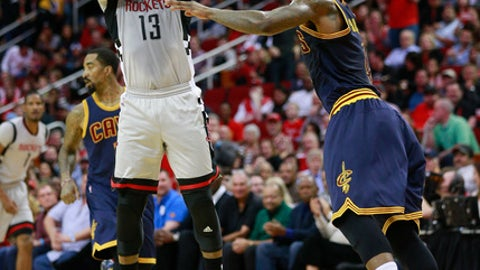 HOUSTON, TX - MARCH 12:  James Harden #13 of the Houston Rockets shoots a three point shot over Iman Shumpert #4 of the Cleveland Cavaliers at Toyota Center on March 12, 2017 in Houston, Texas. NOTE TO USER: User expressly acknowledges and agrees that, by downloading and/or using this photograph, user is consenting to the terms and conditions of the Getty Images License Agreement.  (Photo by Bob Levey/Getty Images)