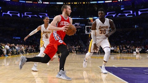 LOS ANGELES, CA - MARCH 12:  Nik Stauskas #11 of the Philadelphia 76ers plays against Jordan Clarkson #6 and Julius Randle #30 of the Los Angeles Lakers on March 12, 2017 at STAPLES Center in Los Angeles, California. NOTE TO USER: User expressly acknowledges and agrees that, by downloading and or using this photograph, User is consenting to the terms and conditions of the Getty Images License Agreement.  (Photo by Robert Laberge/Getty Images)