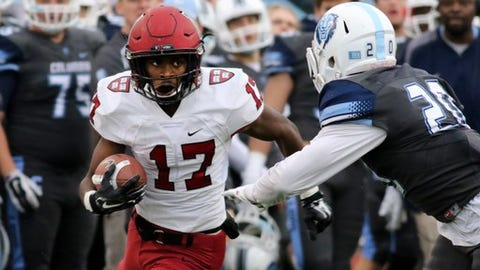 Harvard Crimson's Justice Shelton-Mosley #17 in action against the Columbia Lions during a college football game on Saturday, November 7, 2015 in Manhattan, NY.  Harvard won 24-16. (AP Photo/Gregory Payan)