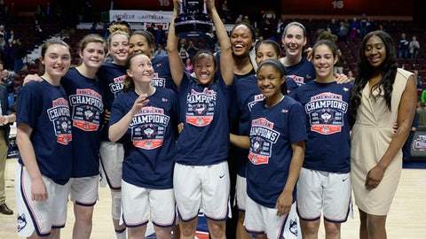 FILE - In this March 6, 2017, file photo, the Connecticut women's basketball team pose with the American Athletic Conference championship trophy after defeating South Florida in an NCAA college basketball game tournament final in Uncasville, Conn.  UConn finishes the season at No. 1 in The Associated Press women's basketball poll for the 14th time in school history. (AP Photo/Jessica Hill, File)