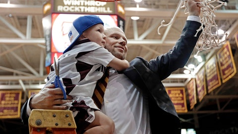 FILE - In this Sunday, March 5, 2017, file photo, Winthrop head coach Pat Kelsey holds his son Johnny as he celebrates cutting down the net after the Big South Conference championship NCAA college basketball game against Campbell in Rock Hill, S.C. (AP Photo/Chuck Burton, File)