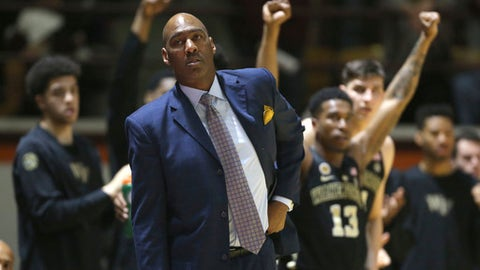 FILE - In this Saturday, March 4, 2017, file photo, Wake Forest head coach Danny Manning watches from the bench during the first half of an NCAA basketball game against Wake Forest in Blacksburg, Va. Whenever John Collins mentions that he plays for Wake Forest, he usually gets a question about his famous coach. Everybody wants to know about Danny and The Miracles. Manning led Kansas to the 1988 national title, knocking off Kansas State along the way. He's got Wake Forest (19-13) back in the NCAA Tournament for the first time in seven years, facing K-State again. (Matt Gentry/The Roanoke Times via AP, File)