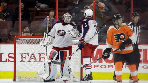 Columbus Blue Jackets' Sergei Bobrovsky, left, and Seth Jones, center, celebrate as Philadelphia Flyers' Matt Read skates off after the Blue Jackets won an NHL hockey game, 5-3, Monday, March 13, 2017, in Philadelphia. (AP Photo/Matt Slocum)