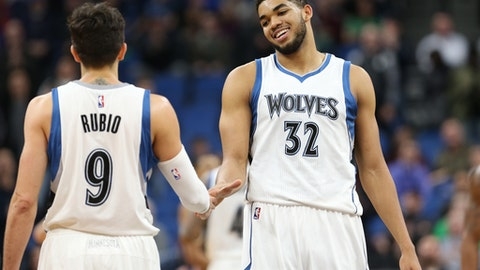 MINNEAPOLIS, MN -  MARCH 13:  Karl-Anthony Towns #32 and Ricky Rubio #9 of the Minnesota Timberwolves high five during the game against the Washington Wizards on March 13, 2017 at Target Center in Minneapolis, Minnesota. NOTE TO USER: User expressly acknowledges and agrees that, by downloading and or using this Photograph, user is consenting to the terms and conditions of the Getty Images License Agreement. Mandatory Copyright Notice: Copyright 2017 NBAE (Photo by Jordan Johnson/NBAE via Getty Images)
