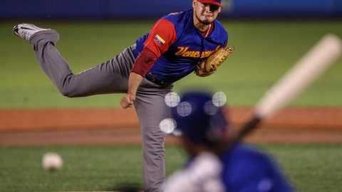 Venezuela's pitcher Omar Bencomo delivers during the first inning of the tie-breaker game against Italy at the World Baseball Classic in Guadalajara, Mexico, Monday, March 13, 2017. (AP Photo/Luis Gutierrez)