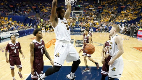 FILE - In this Saturday, March 4, 2017, file photo, Wichita State's Rashard Kelly dunks the ball during the first half of an NCAA college basketball game against the Missouri State in the semifinals of the Missouri Valley Conference men's tournament in St. Louis. (AP Photo/Jeff Roberson, File)