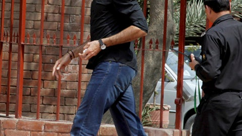 Pakistan's fast bowler Mohammad Irfan arrives at the Pakistan Cricket Board headquarters in Lahore, Pakistan, Tuesday, March 14, 2017. The Pakistan Cricket Board provisionally suspended Irfan on Tuesday for violating the anti-corruption code during the Pakistan Super League. Irfan made a statement to the PCB's anti-corruption unit on Monday. He now has 14 days to respond to the charges. (AP Photo/K.M. Chaduary)