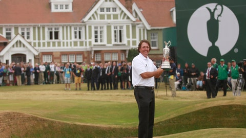 FILE - This is a Sunday July 21, 2013  file photo of Phil Mickelson of the United States holds up the Claret Jug trophy in front of the clubhouse after winning the British Open Golf Championship at Muirfield, Scotland. Muirfield, one of the golf clubs that hosts the British Open, announced Thursday May 19, 2016 that its members voted against allowing women to become members. The R&A, which organizes the British Open, reacted by saying Muirfield will no longer be allowed to stage the major championship. (AP Photo/Peter Morrison, File)