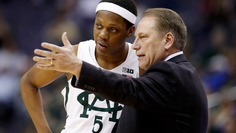 FILE - In this Thursday, March 9, 2017, file photo, Michigan State guard Cassius Winston listens to head coach Tom Izzo during the second half of an NCAA college basketball game against Penn State in the Big Ten tournament in Washington. Izzo has led Michigan State to the NCAA Tournament as usual, extending his streak to 20 years. For a change, the Hall of Fame coach will have to rely on freshmen to avoid losing a first-round exit in consecutive years for the first time. (AP Photo/Alex Brandon, File)