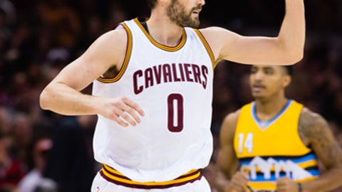 CLEVELAND, OH - FEBRUARY 11: Kevin Love #0 of the Cleveland Cavaliers celebrates after scoring during the first half against the Denver Nuggets  at Quicken Loans Arena on February 11, 2017 in Cleveland, Ohio. NOTE TO USER: User expressly acknowledges and agrees that, by downloading and/or using this photograph, user is consenting to the terms and conditions of the Getty Images License Agreement. Mandatory copyright notice. (Photo by Jason Miller/Getty Images)