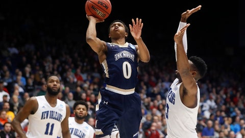 Mount St. Mary's Junior Robinson (0) shoots against New Orleans' Nate Frye (3) in the second half of a First Four game of the NCAA college basketball tournament, Tuesday, March 14, 2017, in Dayton, Ohio. Mount St. Mary's won 67-66. (AP Photo/John Minchillo)