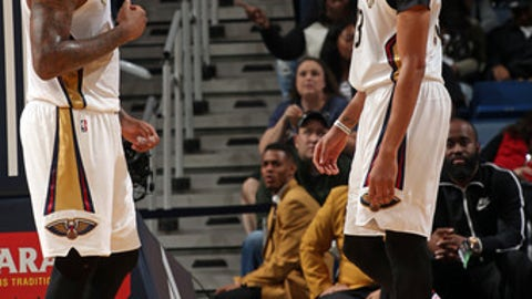 NEW ORLEANS, LA - MARCH 14:  DeMarcus Cousins #0 and Anthony Davis #23 of the New Orleans Pelicans react to his dunk during the game against the Portland Trail Blazers on March 14, 2017 at the Smoothie King Center in New Orleans, Louisiana. NOTE TO USER: User expressly acknowledges and agrees that, by downloading and or using this Photograph, user is consenting to the terms and conditions of the Getty Images License Agreement. Mandatory Copyright Notice: Copyright 2017 NBAE (Photo by Layne Murdoch/NBAE via Getty Images)NEW ORLEANS, LA - MARCH 14:  on March 14, 2017 at the Smoothie King Center in New Orleans, Louisiana. NOTE TO USER: User expressly acknowledges and agrees that, by downloading and or using this Photograph, user is consenting to the terms and conditions of the Getty Images License Agreement. Mandatory Copyright Notice: Copyright 2017 NBAE (Photo by Layne Murdoch/NBAE via Getty Images)
