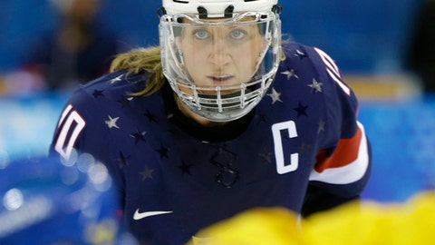 FILE - In this Feb. 17, 2014, file photo, Meghan Duggan of the United States looks up during a face off during the second period of the 2014 Winter Olympics women's semifinal ice hockey game against Sweden at Shayba Arena in Sochi, Russia. The U.S. women's hockey team is threatening to boycott the world championships because of a wage dispute. The team announced Wednesday that they will not participate in the International Ice Hockey Federation tournament that begins March 31, 2017, in Plymouth, Michigan. (AP Photo/Mark Humphrey, File)