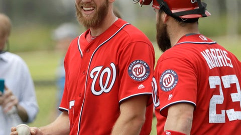 FILE - In this Feb. 16, 2017 file photo, Washington Nationals pitcher Stephen Strasburg, left, talks with catcher Derek Norris (23) after throwing during a spring training baseball workout in West Palm Beach, Fla. The Nationals have unconditionally released Norris, who at one point appeared to be penciled in as Washington's starting catcher but became expendable after the club signed free agent Matt Wieters.  (AP Photo/David J. Phillip, File)