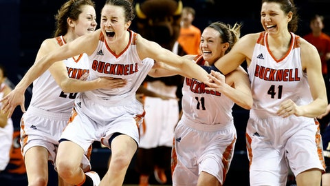 FILE - In this Sunday, March 12, 2017, file photo, Bucknell's Kate Walker (20), Claire DeBoer (12), Megan McGurk (11) and Sune Stewart (41) celebrate after defeating Navy in overtime of an NCAA college basketball Patriot League Championship game in Lewisburg, Pa. DeBoer was a unanimous selection as Patriot League player of the year and also was MVP of the league tournament. (AP Photo/Chris Knight, File)