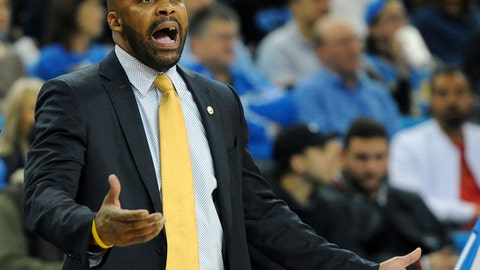 FILE - In this Jan. 5, 2017, file photo, California head coach Cuonzo Martin yells during an NCAA college basketball game against UCLA in Los Angeles, Thursday, Jan. 5, 2017. Martin, who led California's men's basketball for the past three seasons, has resigned as head coach, Athletics Director Mike Williams announced, Wednesday, March 15, 2017. (AP Photo/Michael Owen Baker, File)