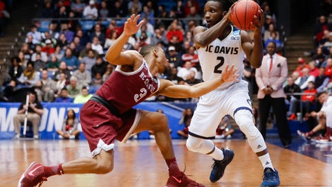UC Davis' Darius Graham (2) looks to pass against North Carolina Central's Rashaun Madison (3) during the second half of a First Four game of the NCAA men's college basketball tournament, Wednesday, March 15, 2017, in Dayton, Ohio. UC Davis won 67-63. (AP Photo/John Minchillo)