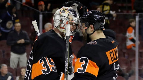 Philadelphia Flyers' Steve Mason, left, and Radko Gudas celebrate after the team's NHL hockey game against the Pittsburgh Penguins, Wednesday, March 15, 2017, in Philadelphia. Philadelphia won 4-0. (AP Photo/Matt Slocum)
