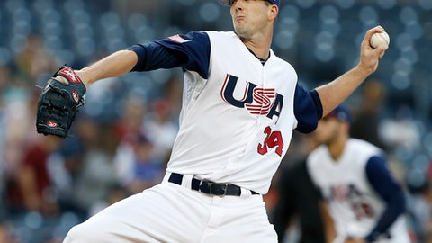 United States starting pitcher Drew Smyly throws to the plate against the Venezuela during the first inning of a second-round World Baseball Classic game in San Diego, Wednesday, March 15, 2017. (AP Photo/Alex Gallardo)a