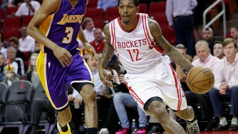 HOUSTON, TX - MARCH 15:  Lou Williams #12 of the Houston Rockets dribbles around Corey Brewer #3 of the Los Angeles Lakers at Toyota Center on March 15, 2017 in Houston, Texas. NOTE TO USER: User expressly acknowledges and agrees that, by downloading and/or using this photograph, user is consenting to the terms and conditions of the Getty Images License Agreement.  (Photo by Bob Levey/Getty Images)