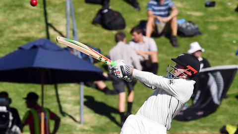 New Zealand's Henry Nicholls hooks a ball to the boundary against South Africa during the second cricket test at the Basin Reserve in Wellington, New Zealand, Thursday, March 16, 2017. (Ross Setford/SNPA via AP)