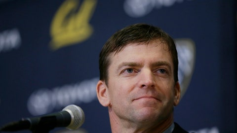 In this Jan. 17, 2017, photo, California football coach Justin Wilcox listens to questions during a news conference in Berkeley, Calif. Wilcox has a tall task ahead of him in his first season as the team's coach. He must learn a roster full of new players, implement his system and rebuild a program that has had little success of late. That process began in earnest Wednesday, March 15, when Wilcox held his first practice ever as a head coach when the Golden Bears opened spring ball. (AP Photo/Eric Risberg)