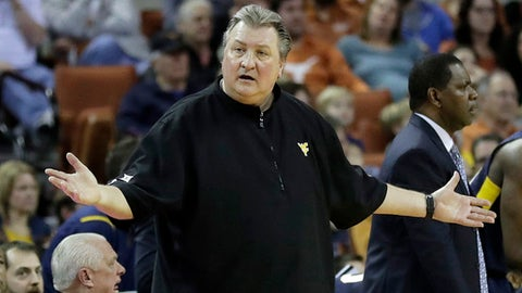 "FILE - In this Jan. 14, 2017, file photo, West Virginia coach Bob Huggins questions a call during the second half of the team's NCAA college basketball game against Texas in Austin, Texas. ""I used to wear a tie. I did the whole deal,"" Huggins said. ""I had tie, vest, I mean the whole deal."" (AP Photo/Eric Gay, File)"