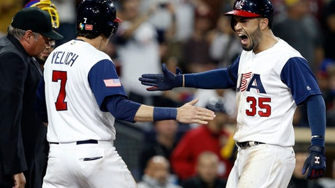 United States' Eric Hosmer, right, celebrates at the plate with Christian Yelich after hitting a two-run home run against Venezuela during the eighth inning of a second-round World Baseball Classic game in San Diego, Wednesday, March 15, 2017. The United States won 4-2. (AP Photo/Alex Gallardo)