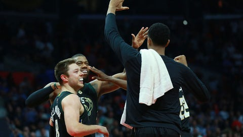 LOS ANGELES, CA - MARCH 15: Matthew Dellavedova #8 and Greg Monroe #15 of the Milwaukee Bucks celebrate with their teammates after defeating the Los Angeles Clippers 97-96 in their NBA game at Staples Center on March 15, 2017 in Los Angeles, California. NOTE TO USER: User expressly acknowledges and agrees that, by downloading and or using this photograph, User is consenting to the terms and conditions of the Getty Images License Agreement.  (Photo by Victor Decolongon/Getty Images)