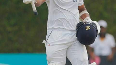 Sri Lankan batsman Dinesh Chandimal acknowledges the crowd scoring a century against Bangladesh on day two of their second test cricket match in Colombo, Sri Lanka, Thursday, March 16, 2017. (AP Photo/Eranga Jayawardena)