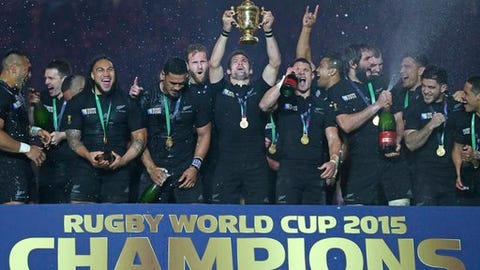 FILE - In this Saturday, Oct. 31, 2015 file photo, New Zealand's captain Richie McCaw holds the Rugby world cup trophy aloft after his team's final victory over Australia at Twickenham in London. The victory formed part of New Zealand's record 18-match winning streak at the highest level, a mark that England hopes to overtake on Saturday, March 18, 2017 when it plays Ireland. (AP Photo/Tim Ireland, File)
