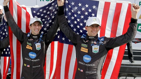 FILE - In this Sunday, Jan. 29, 2017, file photo, brothers Ricky Taylor, left, and Jordan Taylor celebrate in Victory Lane after their team won the IMSA 24-hour auto race at Daytona International Speedway in Daytona Beach, Fla. The defining moment of Ricky Taylor's career may very well have been the closing laps of the Rolex 24 at Daytona, where he used an aggressive pass to secure the biggest win of his career. (AP Photo/John Raoux, File)