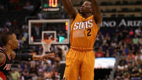 PHOENIX, AZ - MARCH 12:  Eric Bledsoe #2 of the Phoenix Suns attempts a shot against the Portland Trail Blazers during the first half of the NBA game at Talking Stick Resort Arena on March 12, 2017 in Phoenix, Arizona.  NOTE TO USER: User expressly acknowledges and agrees that, by downloading and or using this photograph, User is consenting to the terms and conditions of the Getty Images License Agreement.  (Photo by Christian Petersen/Getty Images)