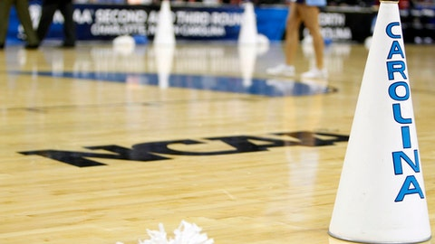 FILE - In this March 20, 2011, file photo, North Carolina cheerleaders perform in the second half of a East Regional NCAA tournament third round college basketball game against Washington, in Charlotte, N.C. For years, March brought the NCAA Tournament to basketball-crazed North Carolina like a fixture of spring. And South Carolina watched from afar, left out due to state-level politics that drew the ire of the NCAA. Those neighboring states are suddenly in reversed roles this weekend, with North Carolina _ host to more tournament games than any other state _ on the outside as South Carolina hosts its first NCAA games in 15 years. (AP Photo/Chuck Burton, File)